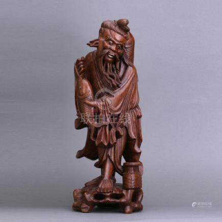 An old carved Huangying wood fishman figure