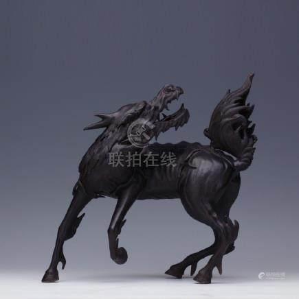 A bronze Qi-Ling figure
