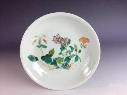 Chinese saucer with floral pattern and mark