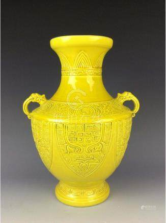 Chinese yellow glaze vessel with zoomorphic mask motif