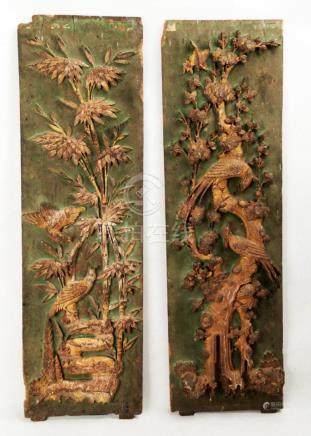 A PAIR OF CARVED WITH FLOWERS AND BIRDS DESIGN CAMPHOR