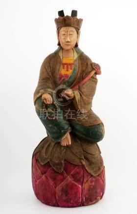 A LACQUERED WOOD FIGURE OF GUANYIN BUDDHA