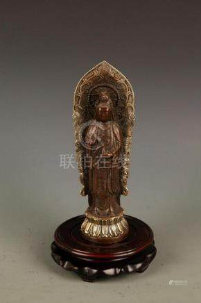 A FINELY MADE GUAN YIN FIGURE WITH HOLLOW