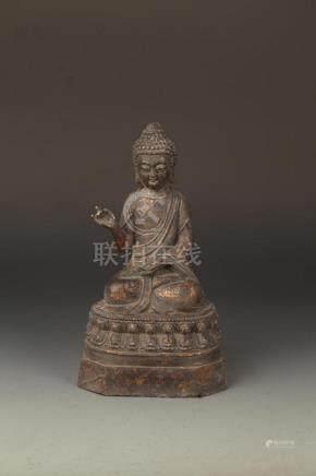 A FINE CAST IRON FIGURE OF TAHAGATA BUDDHA