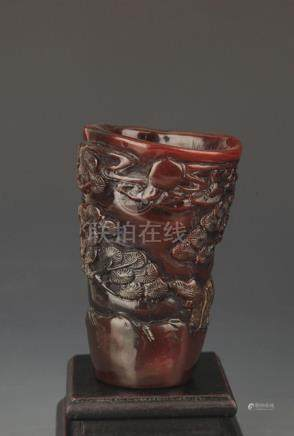 A FINELY CARVED CHINESE CUP