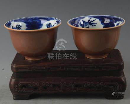 PAIR OF SAUCE GLAZED PORCELAIN CUP