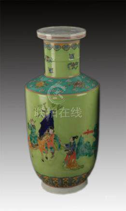 A LIGHT GREEN GROUND FAMILLE ROSE STORY PAINTING VASE
