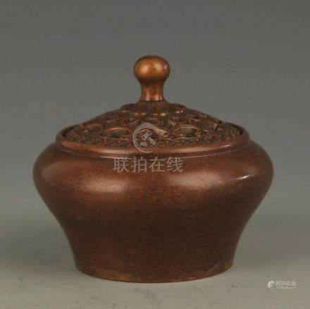 A EARTHENWARE STYLE BRONZE AROMATHERAPY