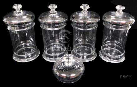 GLASS: Four large clear apothecary jars with domed lids, fla