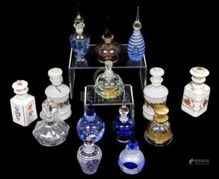 Fourteen cologne/ perfume bottles, 20th C., twelve glass and