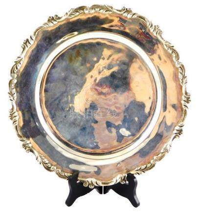 SILVER: Sterling plate, round with scrolled decoration on sc