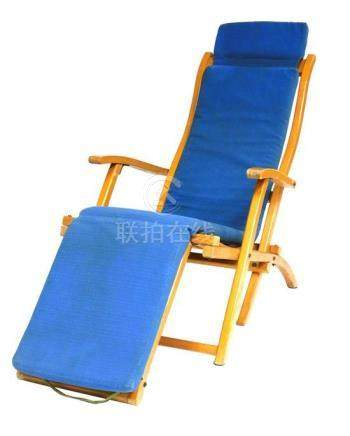 """Wooden reclining deck chair with plaque reading """"The R.M.S."""