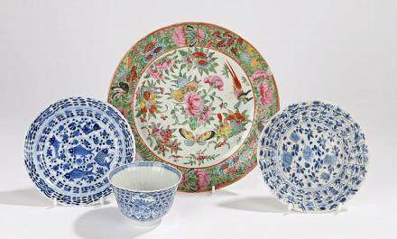 Chinese tea bowl and two saucers decorated with flowers and