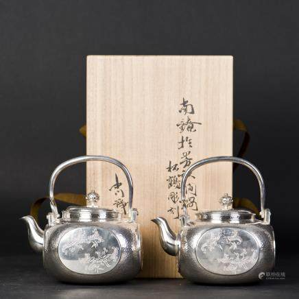 A PAIR OF ARCHAISTIC JAPANESE SILVER TEAPOTS