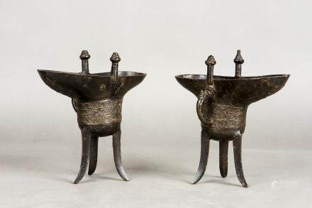 A PAIR OF BRONZE WINE CUPS