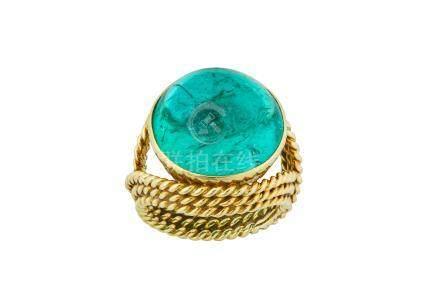 An emerald dress ring