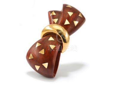 A wood and gold brooch, by Van Cleef & Arpels, 1980