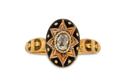 A late 19th century enamel and diamond ring