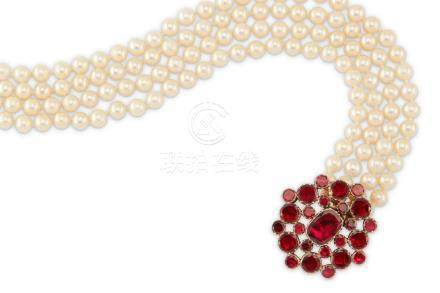A cultured pearl necklace with an early 19th century garnet clasp