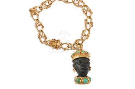 A bracelet with a Blackamoor charm, circa 1955
