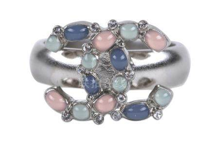 Chanel Gripoix Ring, c. 2017, brushed silver metal with pale blue, green and pink CC design, fits
