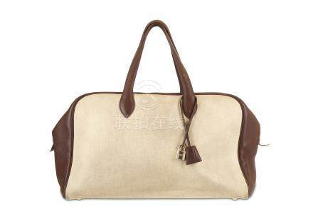 Hermes Canvas and Brown Leather Victoria Travel Bag, beige canvas with dark brown leather trim, gold
