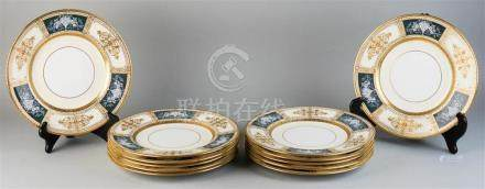 SET OF TWELVE MINTON PATE-SUR-PATE DECORATED SERVICE PLATES,