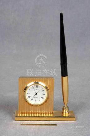 Reloj de sobremesa con soporte para bolígrafo, de la marca j