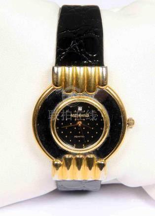 Reloj tipo MOSCHINO, en dorado y plateado con esfera en negr