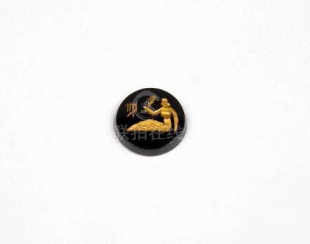 Ónix circular decorado con signo de Piscis en oro.