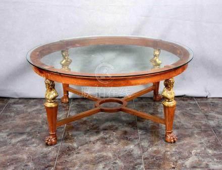 Mesa de centro circular en madera con tapa en cristal, patas