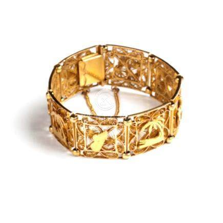 A GOLD BRACELET each rectangular linked panel centred by a relief scene depicting figures and