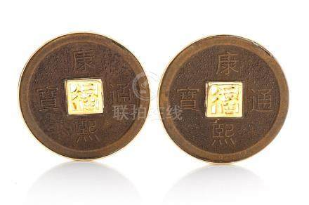 A PAIR OF CHINESE COIN EARRINGS each coin with clip and pin mechanism (2)