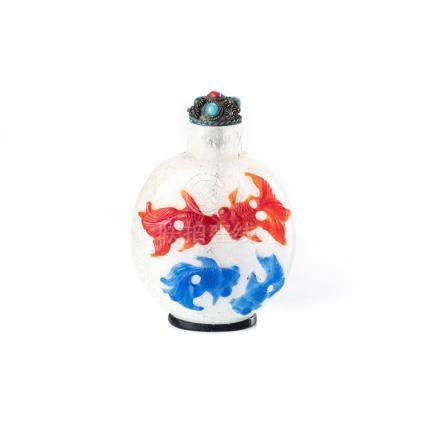 A CHINESE CARVED MULTI-COLOUR GLASS OVERLAY 'SNOWFLAKE' SNUFF BOTTLE ovoid, the front carved with