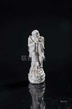 A CHINESE 'BLANC DE CHINE' FIGURE OF THE IMMORTAL LI TIEGUAI raised on a domed cloud-shaped base