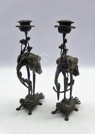Pair of Chinese bronze 'Crane and Turtle' candlesticks, 19th Century,