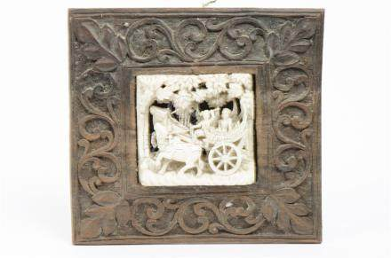 A 19th Century Chinese ivory openwork carving of two figures in a cart pulled by oxen under a canopy
