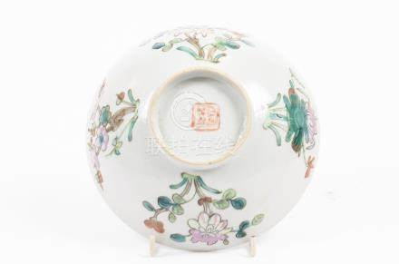 An early 20th Century Chinese porcelain bowl, enamel floral decoration, four character marks to