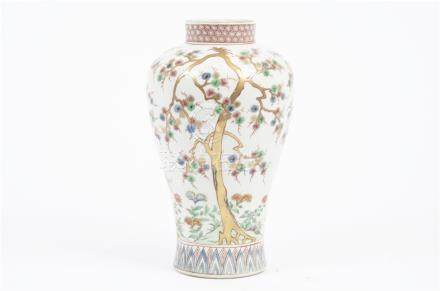 A Chinese famille verte baluster vase converted to lamp base, decorated with prunus, 29.5 cm high