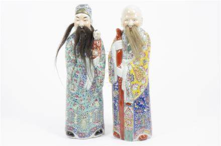Two Chinese porcelain deities from the trio of the 'Stars of Happiness', comprising Fuxing with a