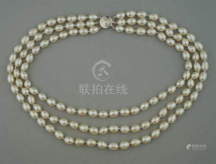 TRIPLE STRAND FRESHWATER PEARL STRAND WITH STERLING SILVER C