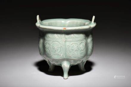 LIGHT CELADON GLAZED 'FLOWERS' TRIPOD CENSER WITH HANDLES