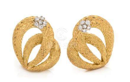 A Pair of 18 Karat Yellow Gold and Diamond Earclips,
