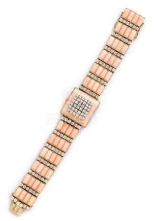An 18 Karat Bicolor Gold, Diamond and Coral Wristwatch,