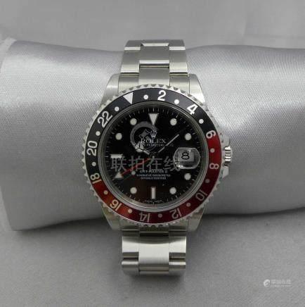Une montre tour de bras d'homme ROLEX Oyster Perpetual Date GMT-Master II, en