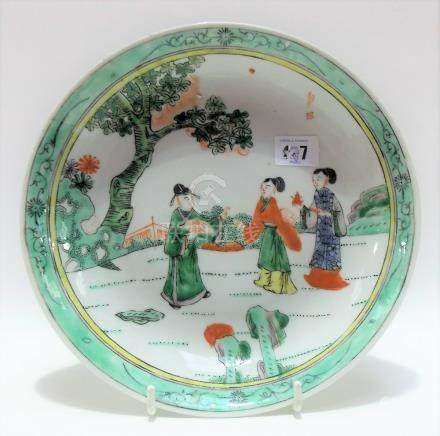 Chinese famille verte dish, painted with three figures within a garden, painted with a seal mark