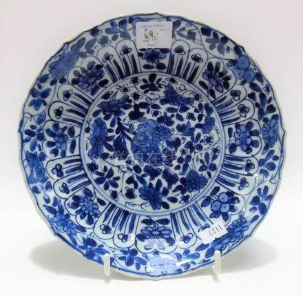 Chinese Kangxi period blue and white decorated shallow bowl, the moulded rim decorated with