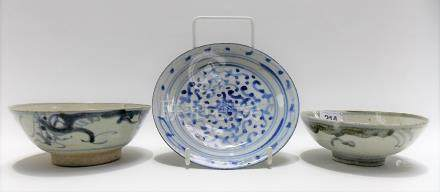 Two Chinese Provincial underglaze decorated bowls together with a blue and white dish (3)