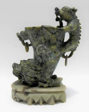 Chinese soapstone libation cup carved with a mythical creature looking over the bowl and with