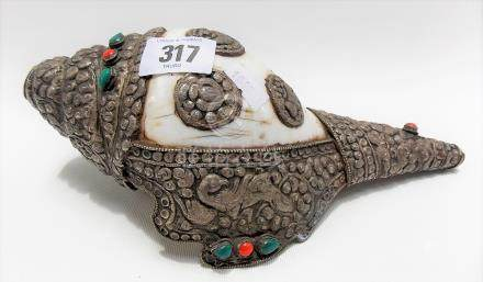 Tibetan white metal and hard stone mounted conch shell horn, the mount repousse decorated, length